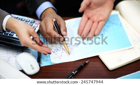 Close-up of Business people discussing a financial plan - stock photo
