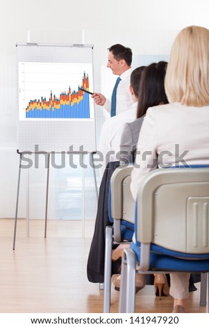 Close Up Of Business People Discussing New Project - stock photo