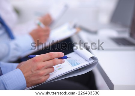 Close-up of Business people. Financial plan - stock photo