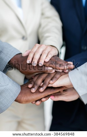 close up of business people hands together - stock photo