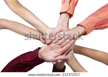 Close-up of business people joining their hands on white background