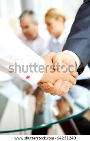 Close-up of business people making agreement in the office - stock photo