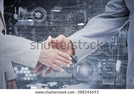 Close up of business people shaking their hands against hologram background