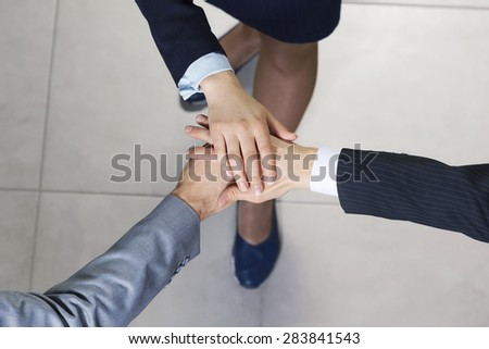 Close up of business peoples hands on top of each other