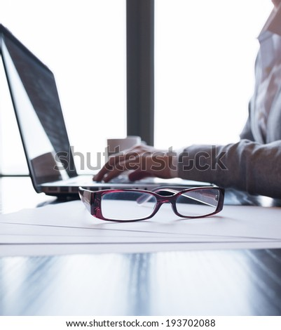 Close up of business person using laptop. - stock photo