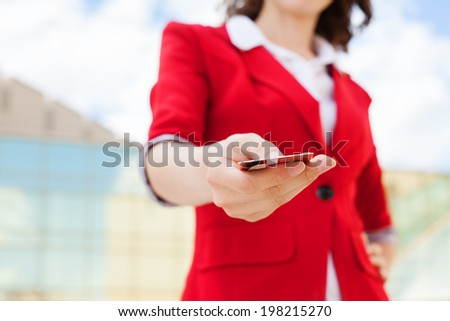 Close-up of business woman holding credit card - stock photo