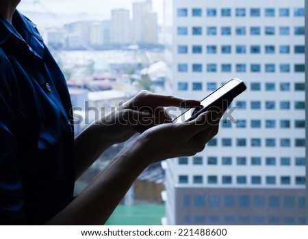 Close up of business woman using smart phone mobile - stock photo