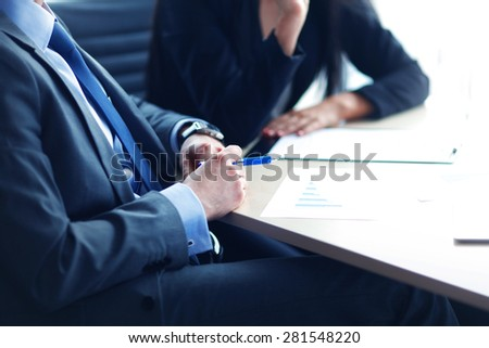 close-up of businessman at desk - stock photo