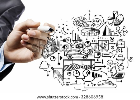 Close up of businessman drawing business sketches on screen - stock photo