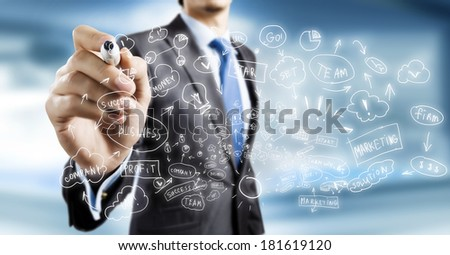 Close up of businessman drawing business strategy plan - stock photo