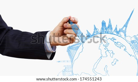 Close up of businessman drawing Earth planet