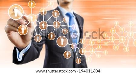 Close up of businessman drawing social net symbols - stock photo