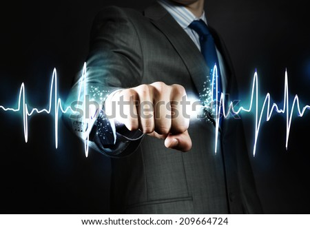 Close up of businessman hand clenching graph in fist - stock photo