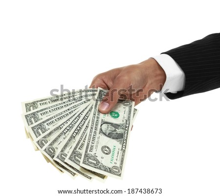 Close up of businessman hand holding a fan of dollar bills