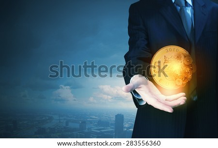 Close up of businessman hand holding euro sign