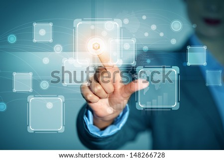 Close up of businessman hand pushing icon on media screen