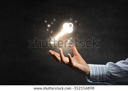 Close up of businessman hand showing key to success - stock photo