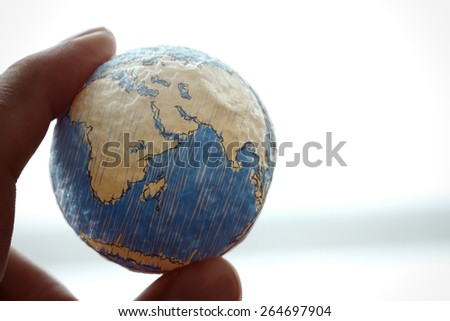 close up of businessman hand showing texture the world concept Elements of this image furnished by NASA