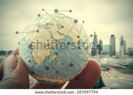 close up of businessman hand showing texture the world with digital social media network diagram concept Elements of this image furnished by NASA london city background - stock photo