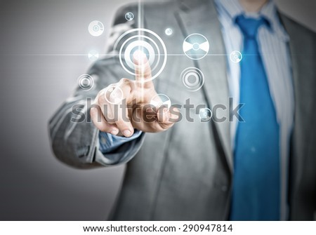 Close up of businessman hand touching icon of media screen