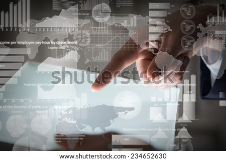 Close up of businessman hand touching tablet screen