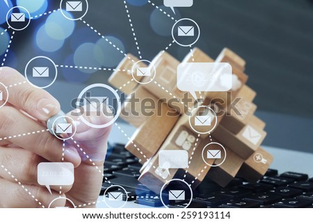 close up of businessman hand use interactive computer with virtual email icon as concept - stock photo