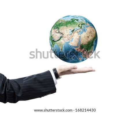 Close up of businessman hand with Earth planet in palm. Travel concept. Elements of this image are furnished by NASA - stock photo