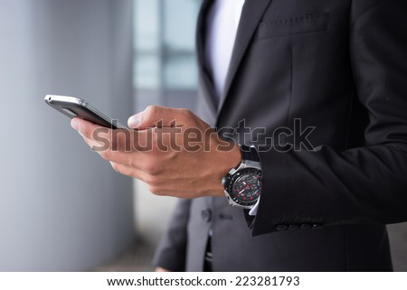 Close-up of businessman hands and smartphone