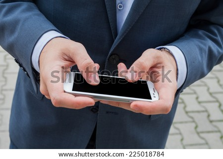 Close up of businessman hands with mobile phone. Copy space
