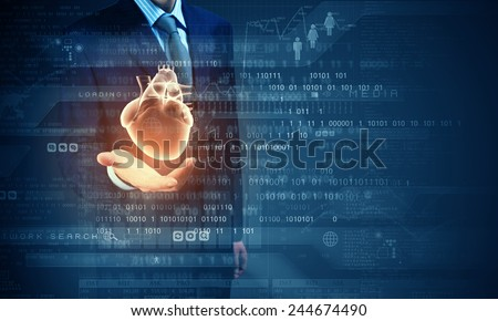 Close up of businessman holding digital heart in palm - stock photo