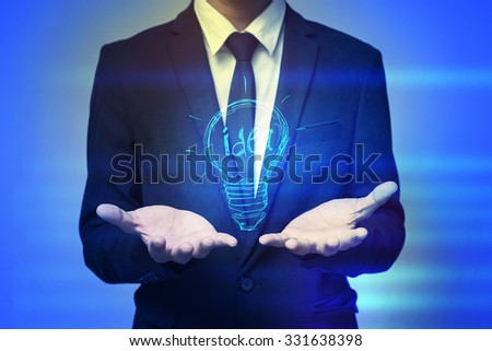 Close up of businessman holding idea in palms