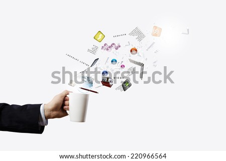 Close up of businessman holding white cup with icons flying out - stock photo