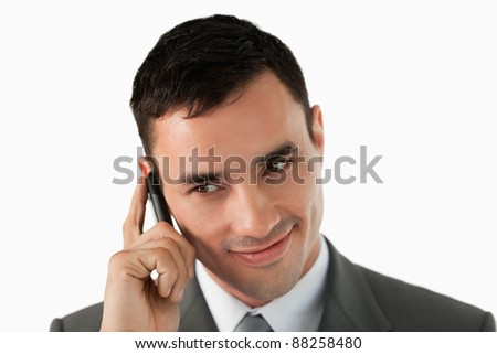 Close up of businessman on his cellphone against a white background