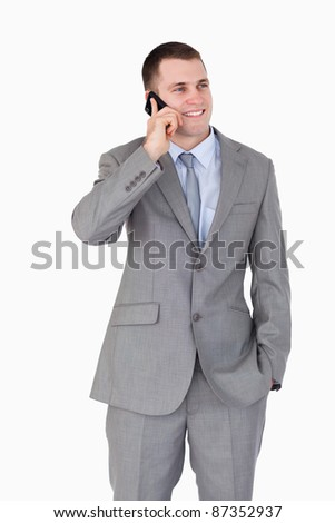 Close up of businessman on the mobile phone on white background