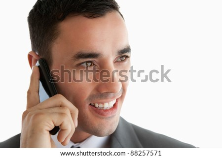 Close up of businessman on the phone looking to the side against a white background