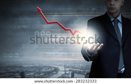 Close up of businessman presenting growing graph
