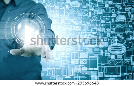 Close up of businessman pressing virtual icon on screen - stock photo