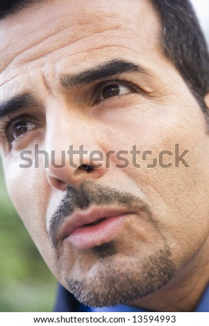 Close-up of businessman's face looking off camera - stock photo