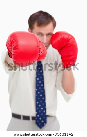 Close up of businessman's fist attacking against a white background