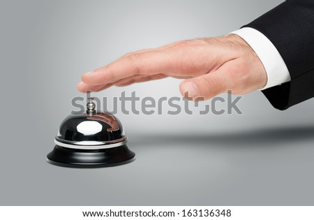 Close up of businessman's hand pressing a service bell - stock photo