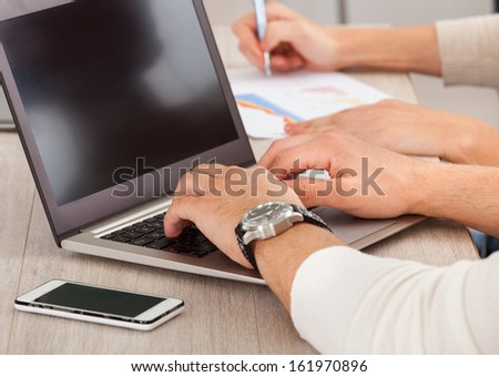 Close Up Of Businessman's Hand Working With Laptop In The Office