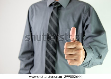 Close up of businessman showing thumb up