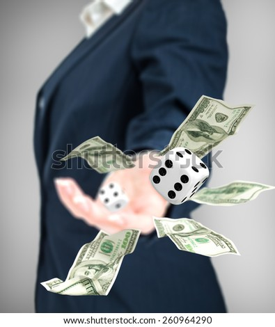 Close up of businessman throwing dice and dollars. Gambling concept. - stock photo