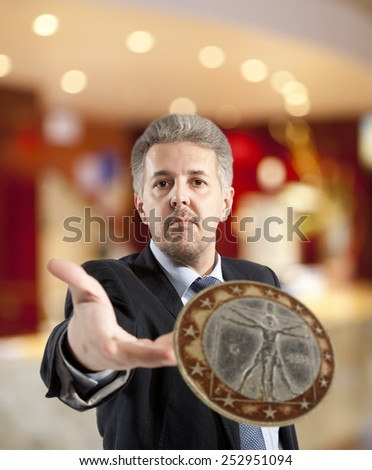 Close up of businessman throws a coin - stock photo