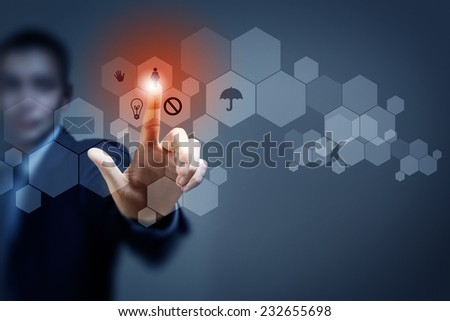 Close up of businessman touching icon of media screen