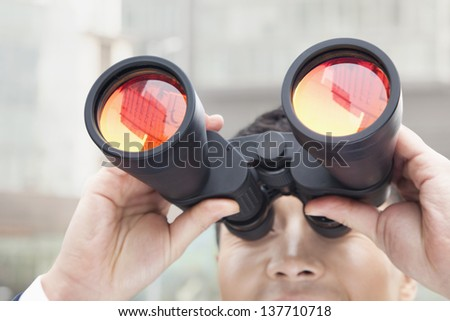 Close Up of Businessman Using Binoculars, Reflection - stock photo
