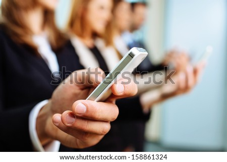 Close up of businessman using smartphone. Business concept
