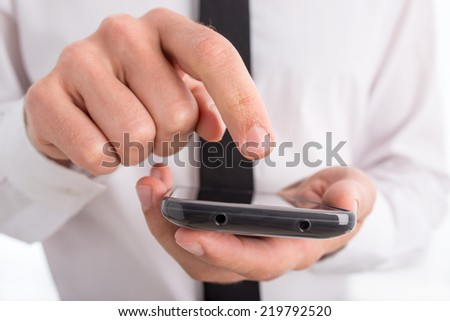 Close Up of Businessman Using Touch Screen Smartphone.