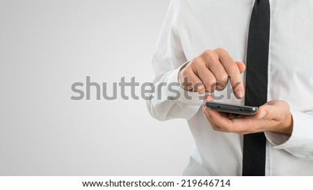 Close Up of Businessman Using Touch Screen Smartphone with Copyspace. - stock photo
