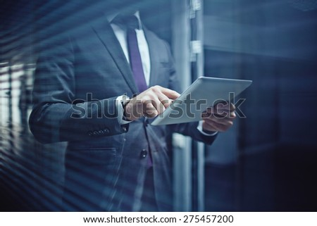 Close-up of businessman using touchpad - stock photo